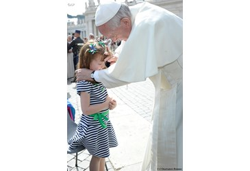 Pope Francis blesses young girl with rare condition