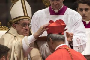 Pope Francis gives the traditional biretta hat to new cardinal Patrick D'Rozario of Bangladesh during a consistory ceremony to install 17 new cardinals in Saint Peter's Basilica at the Vatican November 19, 2016. Photo: Reuters