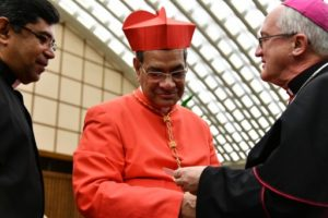 Newly elevated cardinal, archbishop of Dhaka, Patrick D'Rozario, attends a courtesy visit following a consistory on November 19, 2016 at the Paul VI audience hall in Vatican. Pope Francis created 17 new cardinals from across the globe Saturday, elevating them in a time-honoured ceremony to an elite body that advises and elects popes. Three of them are from the US, while others come from corners of the world where the Catholic Church needs a boost. Photo AFP