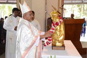Archbishop Moses Costa, csc placing the relic of St Anthony in the Altar