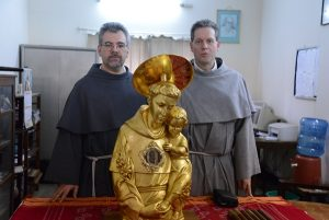 from left Fr. Alesandro and Fr. Paulo with St. Anthony's Relic
