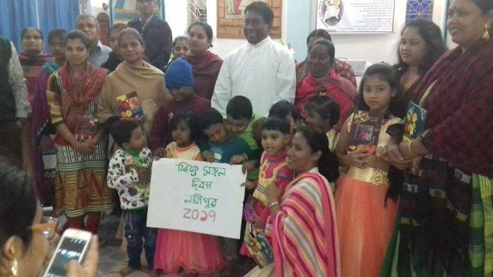 Fr. Robert Gonsalves with Children of Shahebganj